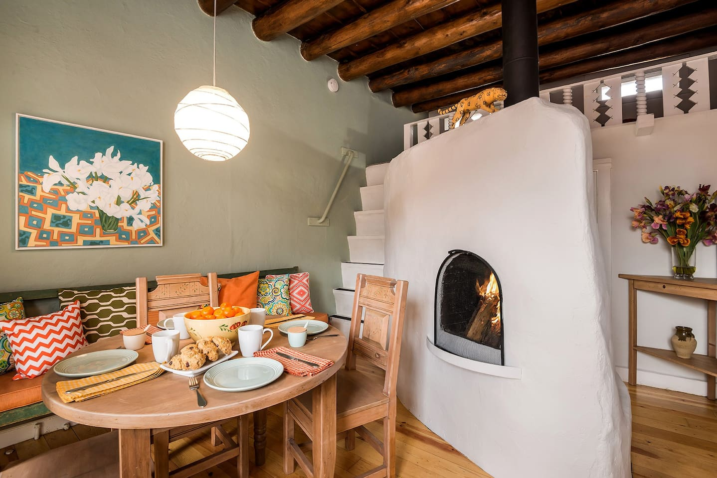 Kitchen Table, Fireplace and Loft Staircase