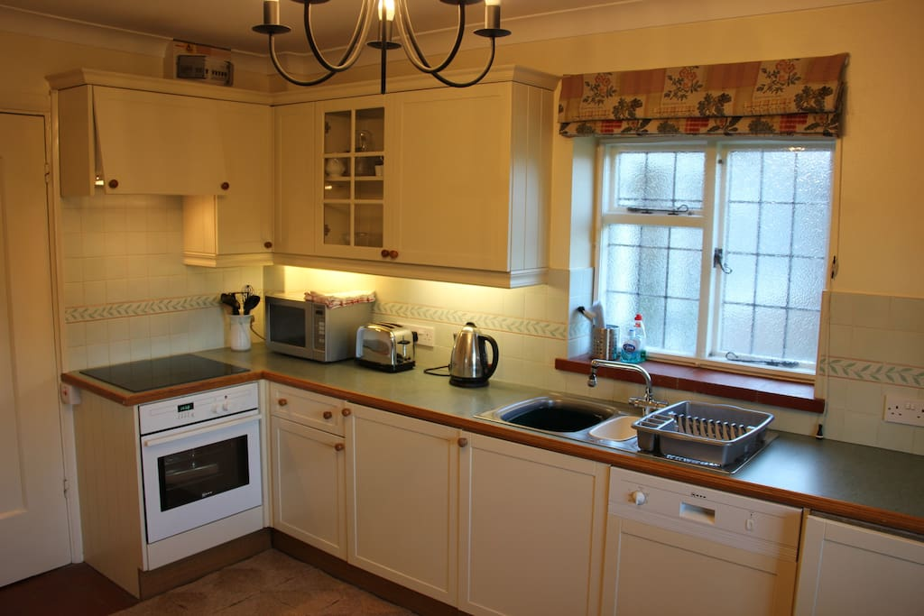 Kitchen with induction hob, fan oven, mw, fridge, dishwasher & washer dryer
