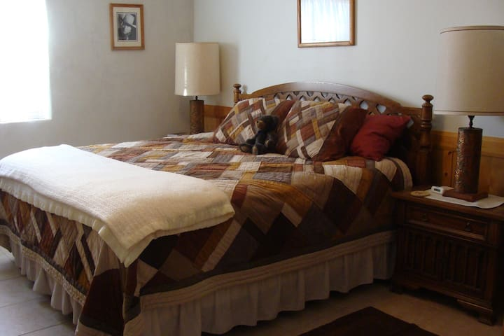 Private bedroom, western theme /w King size bed. Bright and airy.
