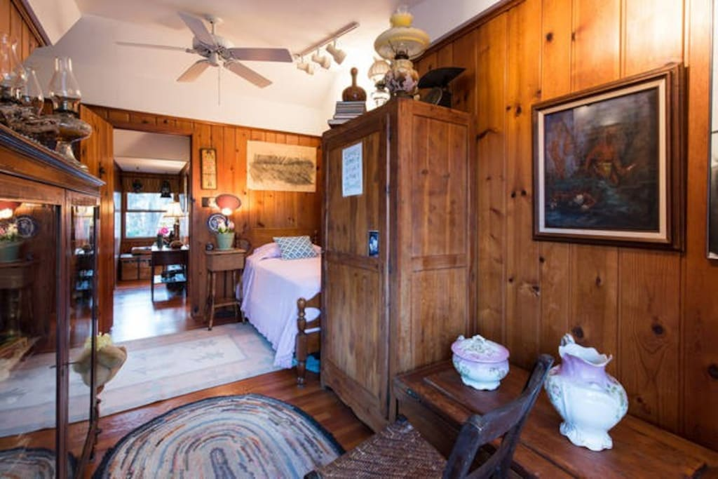 Great room with ceiling fan and antiques/full bathroom downstairs one floor