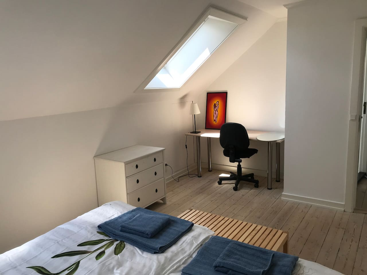 Bright room with double bed.