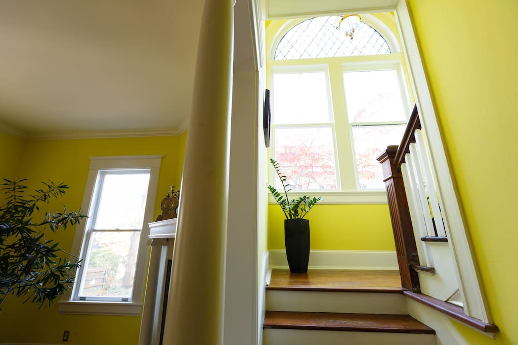 Front staircase with original Victorian windows.
