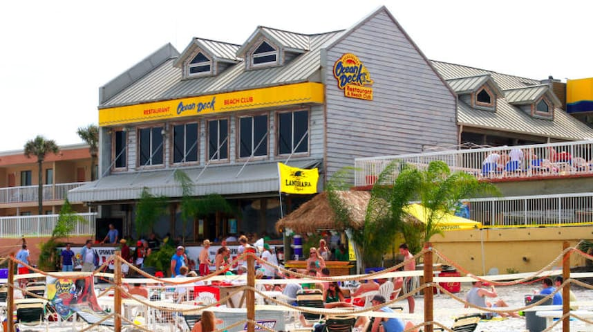 The great OCEAN DECK TIKI BAR! A locals favorite! Super laid back vibe, great food and drinks, sits DIRECTLY on the beach sand!