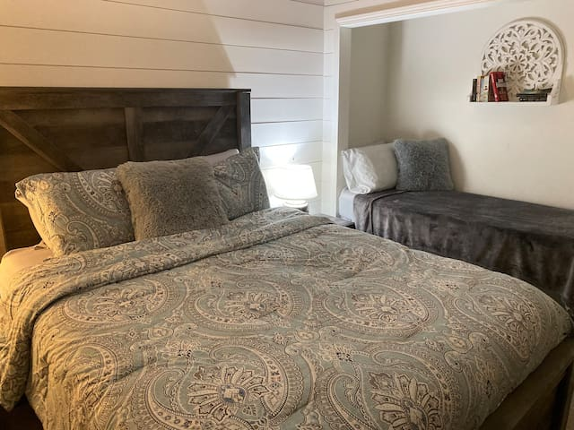 Guest bedroom main level (2nd) with queen bed and twin reading nook. Sleeps 3.
