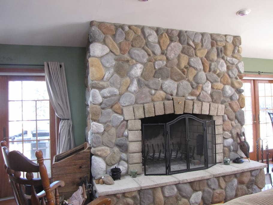 """Murphy's Den and Conference room. Seats 40 with bar, wall mounted 67"""" flat screen, wrap around deck and outside fireplace."""