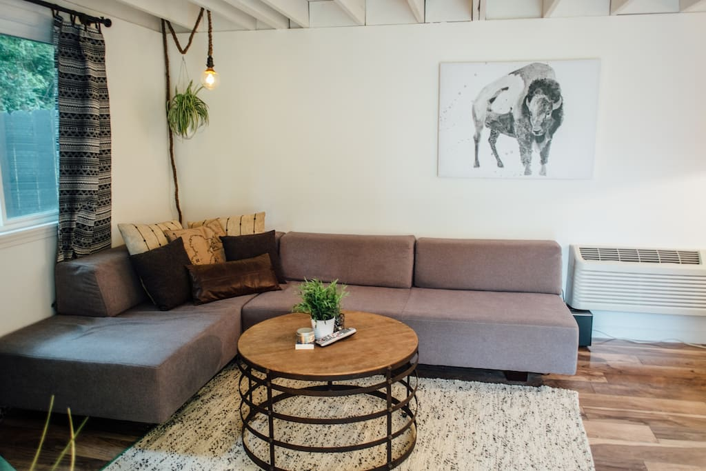 West Elm modular sectional couch easily turns into 2 comfy twin beds.  Linens provided!