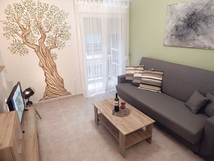 The apartment is redesigned and decorated by a Greek Artist, following a concept inspired by the famous Greek ancient Olive Tree