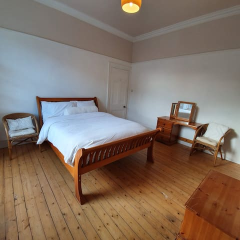 Spacious double bedroom in large granite house