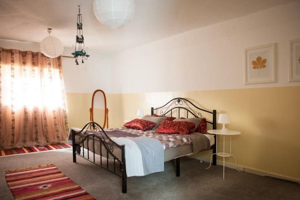 A room with one double bed and a single bed.