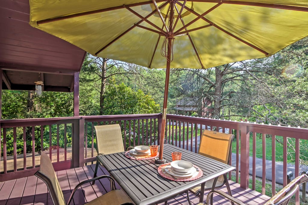 Dine al fresco on the balcony overlooking the dense forest.