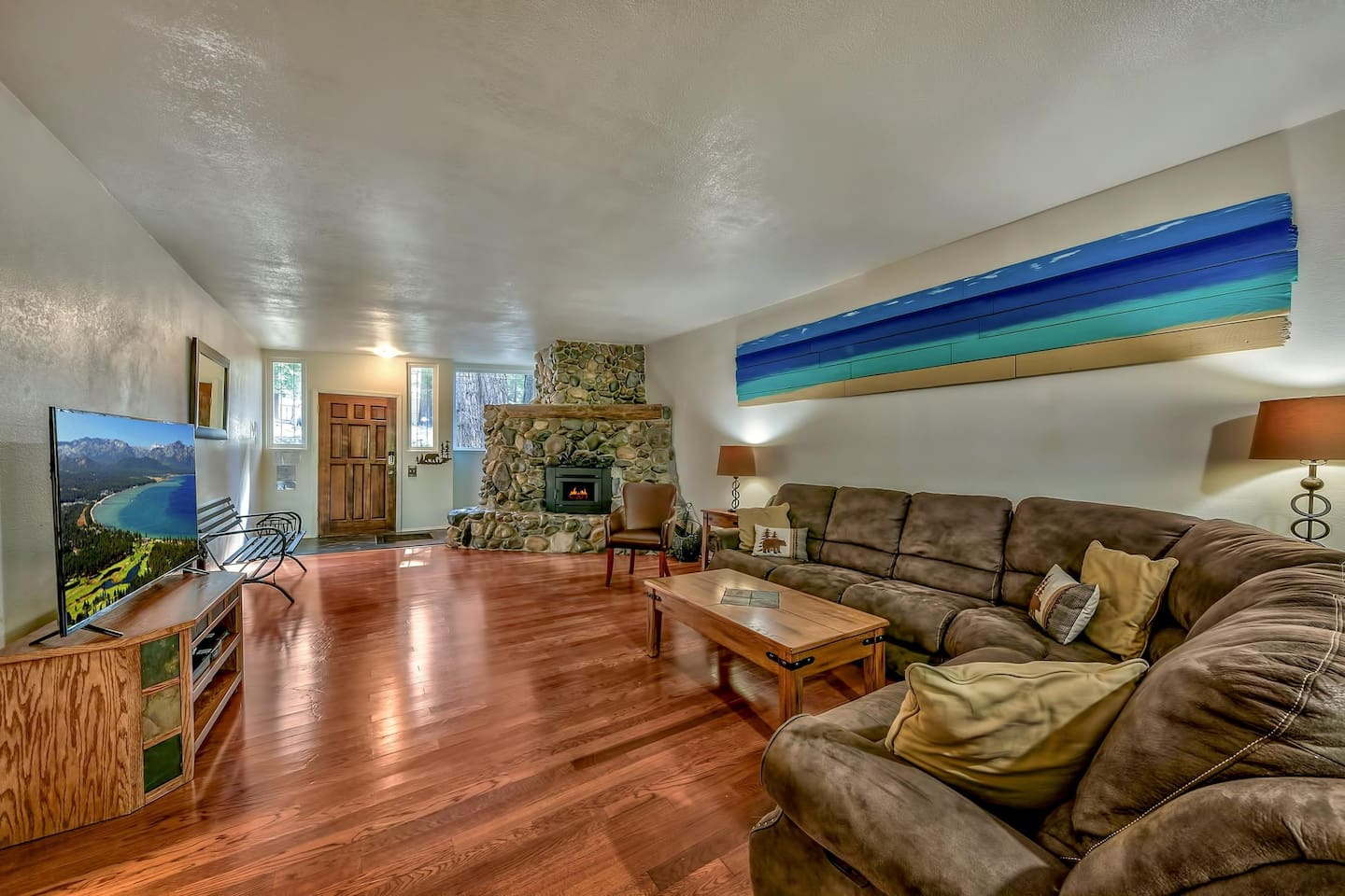 Fun for the whole family! Gather in the large living room with fireplace (now a wood-stove insert), HDTV, and views of the forest outside