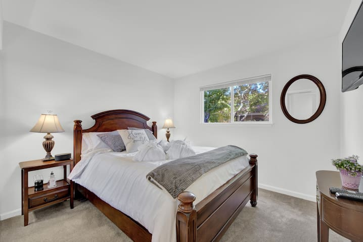 Comfortable queen bed with luxurious linens and duvet, tv, clock radio with phone charger and blue-tooth music.  Window coverings recently updated toPlantation Shutters