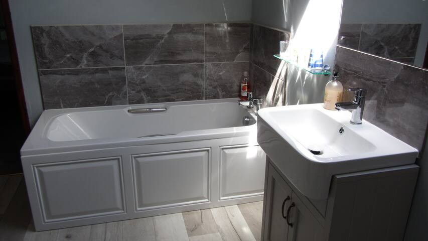 Full sized separate bath.