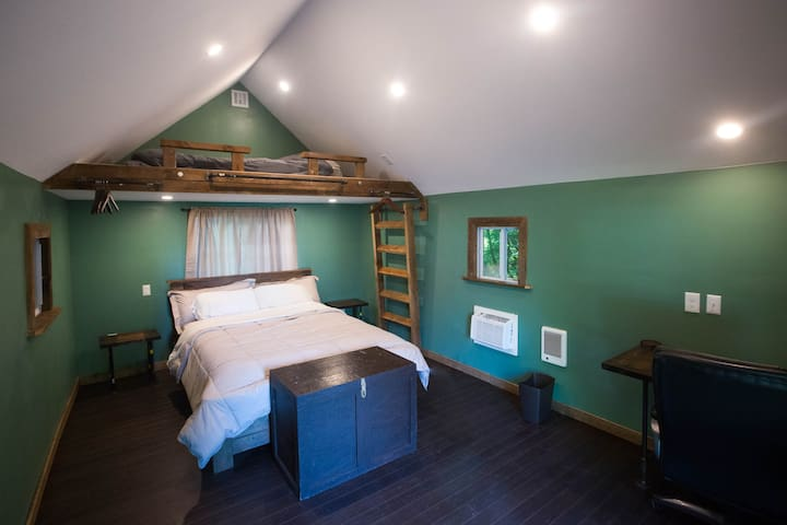 Inside of the newly remodeled guest cabin, queen bed & loft.