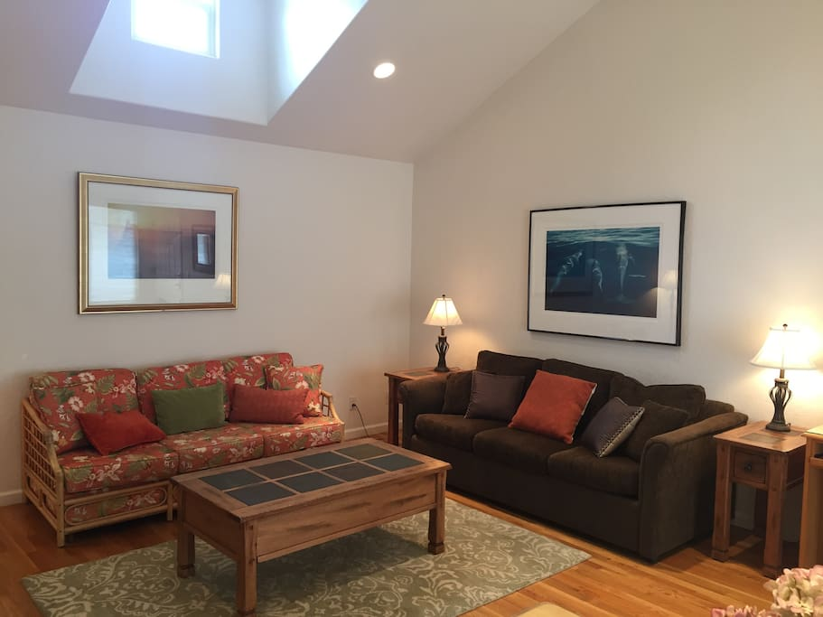 Cozy living room adjacent to dining area