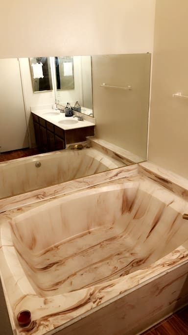 Master Bathroom (marble tile jacuzzi bathtub, dual sink, & toilet room)