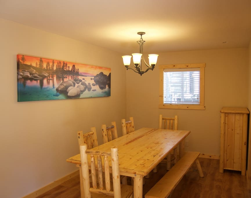 Dinning room with 8' award winning picture of Tahoe and seating for 8