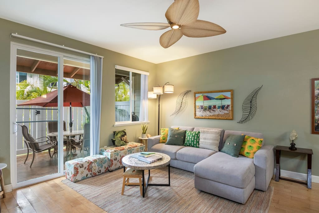 Spacious living room with plenty of seatings and emerge yourself in the cottage vibe decor.