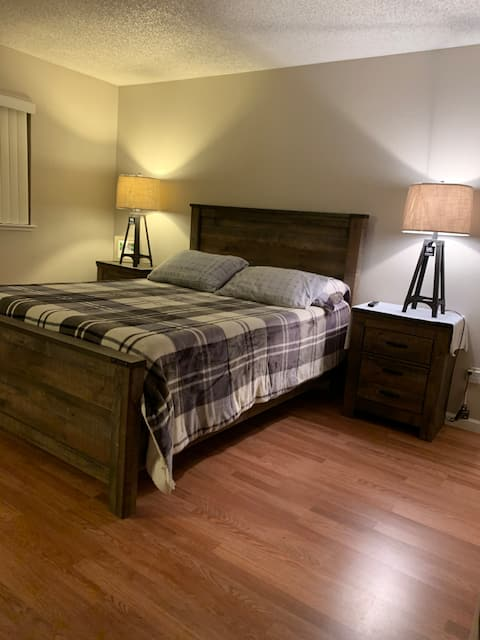 Cozy living with brand new master bedroom set.