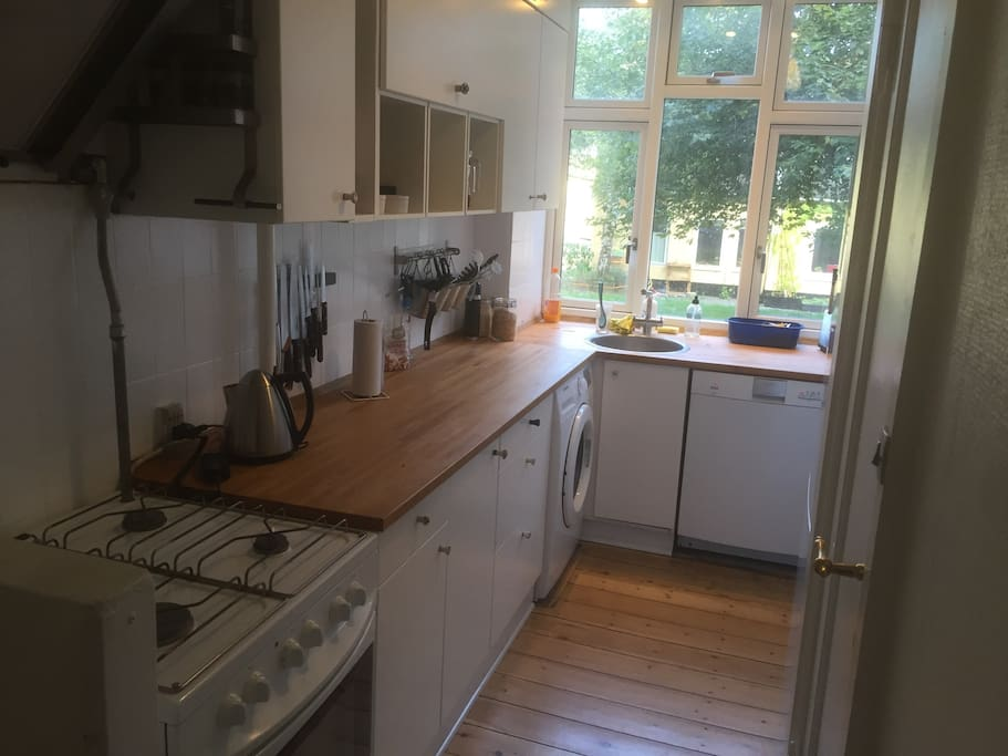 Spacious kitchen with room for two masterchefs at once. + Washing machine and dishwasher