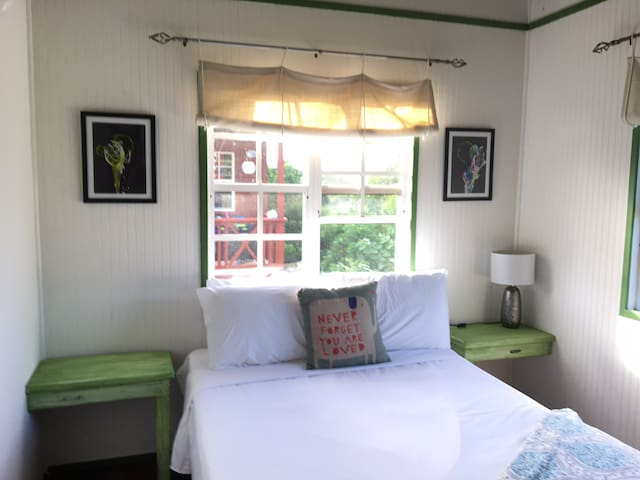 Private bedroom with ceiling and standing fan
