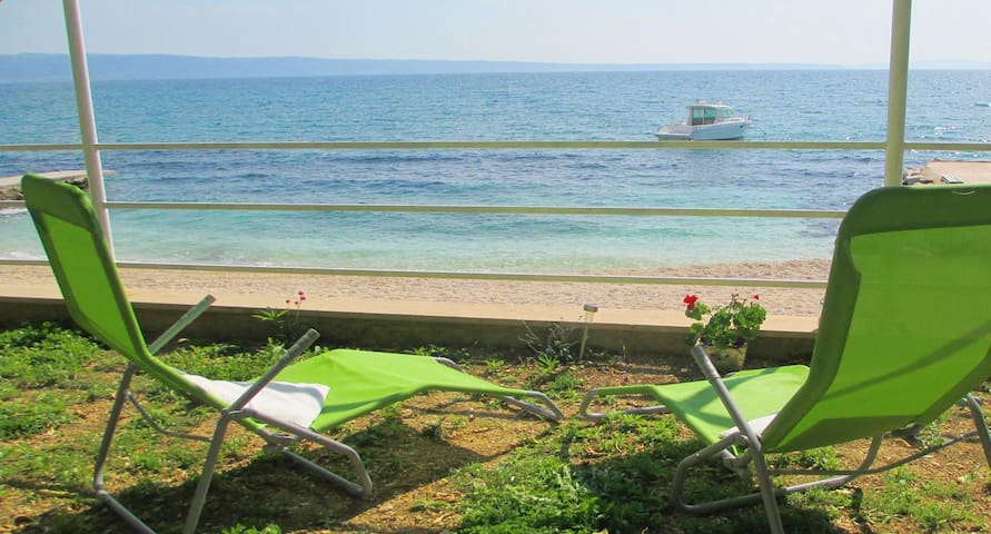 """""""You can choose to have breakfast indoors with a sea view, in front of the house (at the beach!) or in a lovely garden underneath lemon trees."""" (Stefan)"""