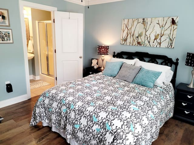 First floor private bedroom with full private bathroom with TV, mini fridge and microwave.