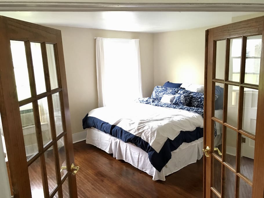 Master bedroom with king-sized bed and large dresser.