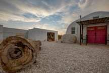 """The beautiful Joshua Tree sky above the entrance of the main dome and the """"Area 51"""" lounge shipping container."""