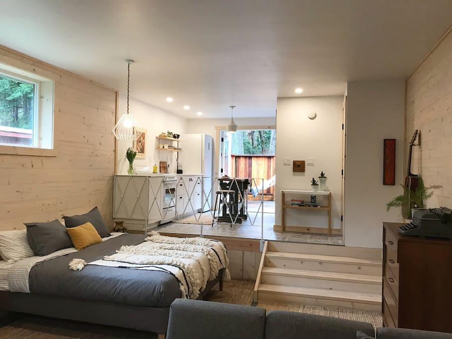 Loft Style Studio with overheight ceilings, concrete floors and pine board walls.