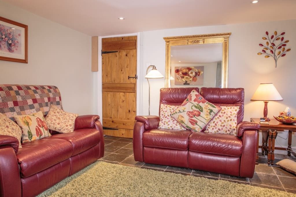 Leather reclining sofas in sitting room