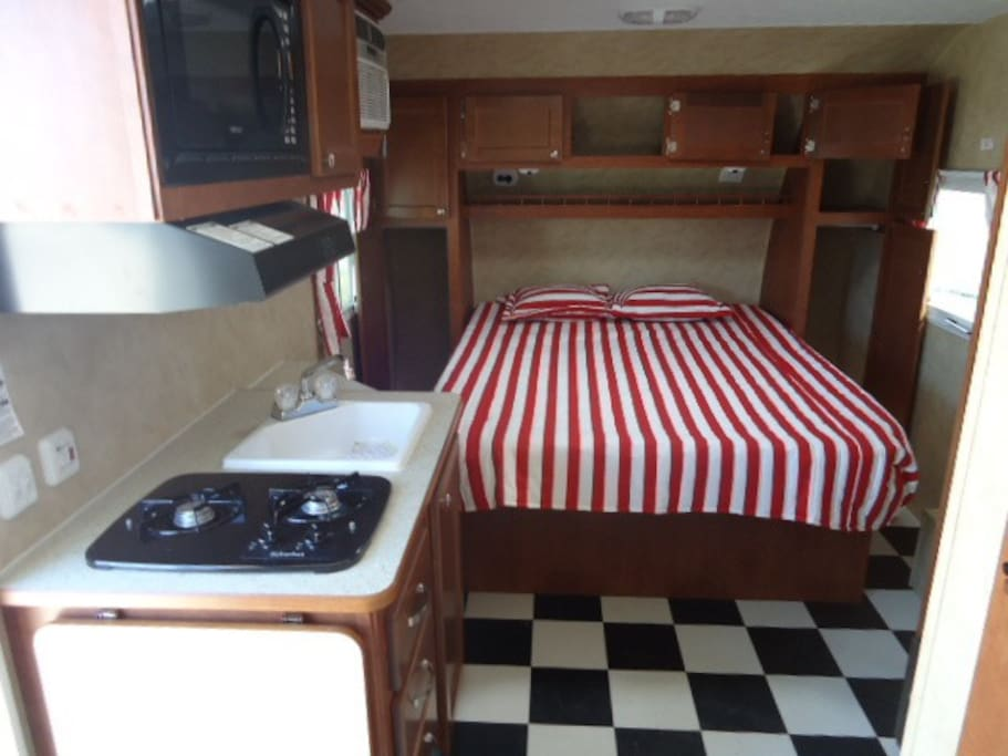 This is the inside view of the kitchenette and the full sized bed.