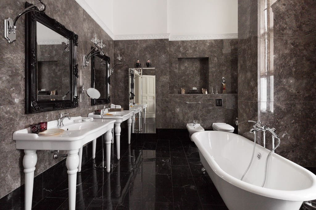 Shared Marble Bathroom with Tub and Shower