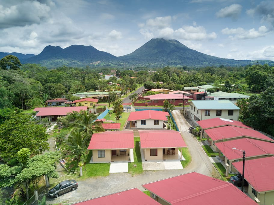 View of the  neighborhood with the Arenal Volcano in front, just 5 blocks to downtown La Fortuna