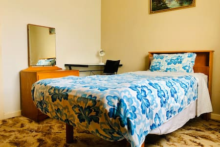 Furnished room walk to local shops close air port