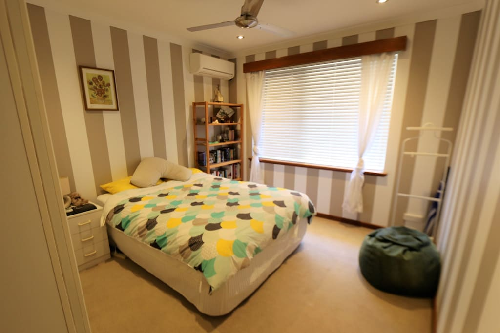 Bedroom with queen bed, aircon/heating, ceiling fan, storage & lockable door