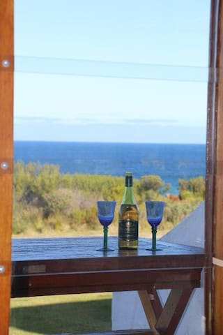 Enjoy wine on the front front porch.