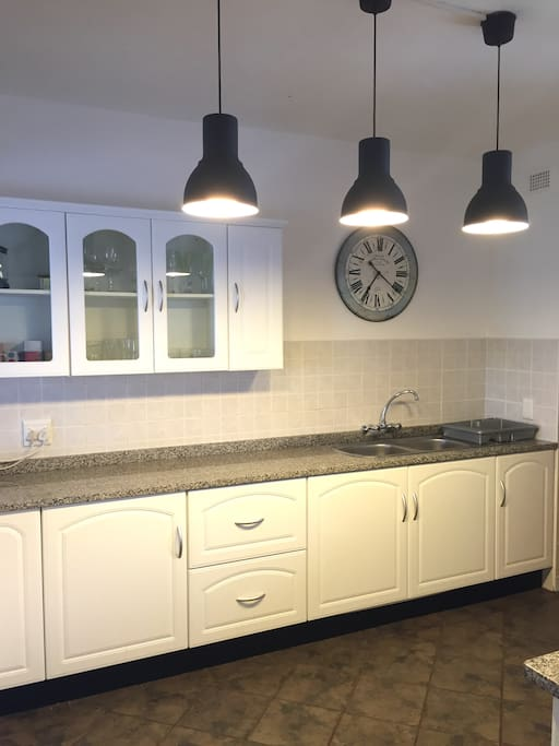 Open plan kitchen is fully equipped with laundry and dishwasher