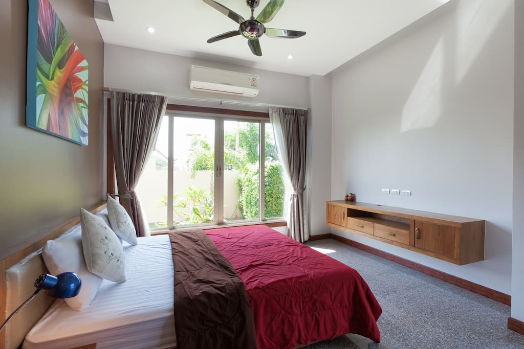 Large bedroom with ensuite shower opening on to the garden
