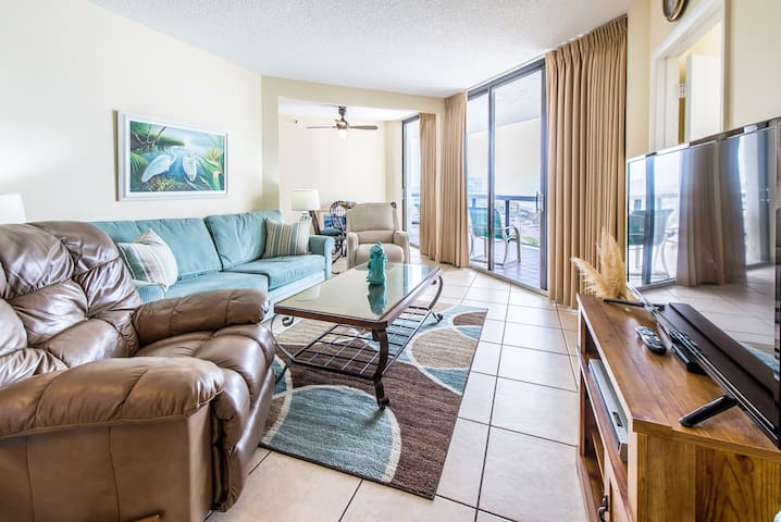 Large flat screen and balcony access in living rm