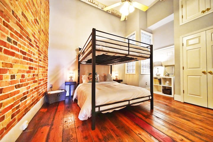 """Large second bedroom with 2 queen beds, super comfy memory foam mattresses, closet, shelves, nightstands with built-in outlets, and plenty of extras! """"Skylight"""", frosted, wall feature allows natural light."""