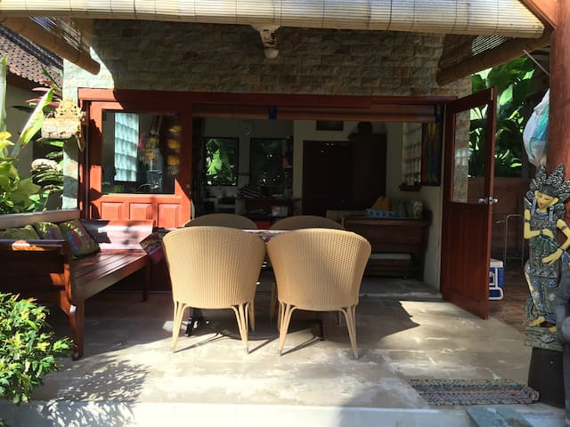 Comfortable outside day bed and eating area