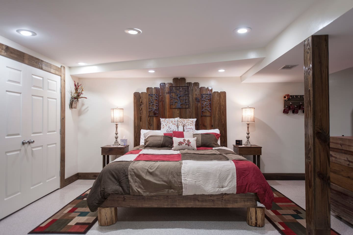 King size bed with cedar posts. The headboard, trim and most of the furniture is made from refurbished Fence wood.