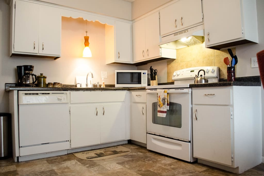 Adorable kitchen with lots of space and supplies for entertaining and eating in!