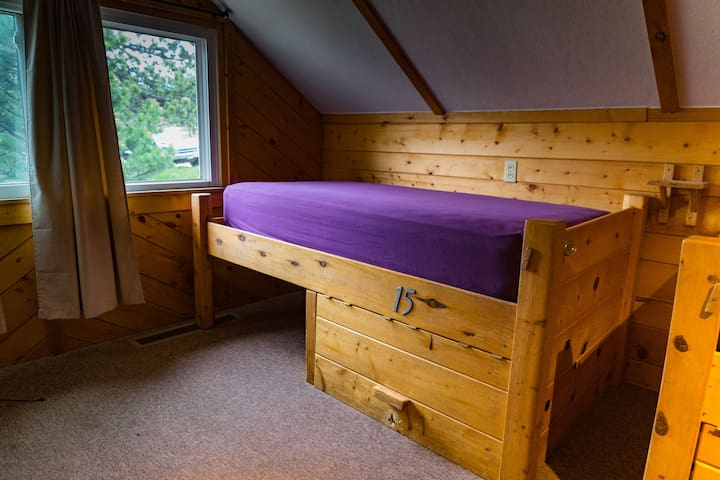 Image of the beds up close. Lockable storage underneath.