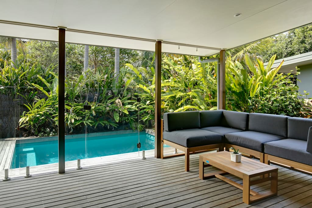 Living room opens onto pool deck