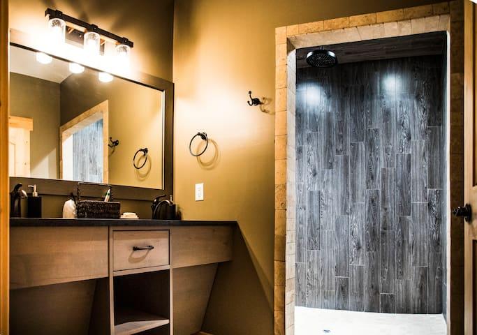Beautiful Modern Restroom. His/Her Sink plus rainfall tile shower.