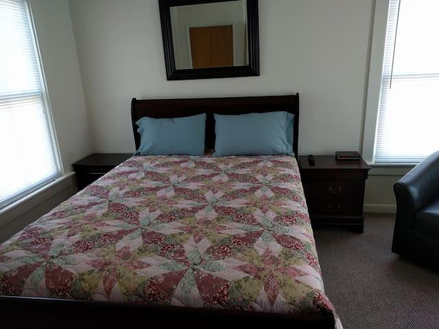 Front Bedroom with Queen Bed, two nightstands, Clock Radio