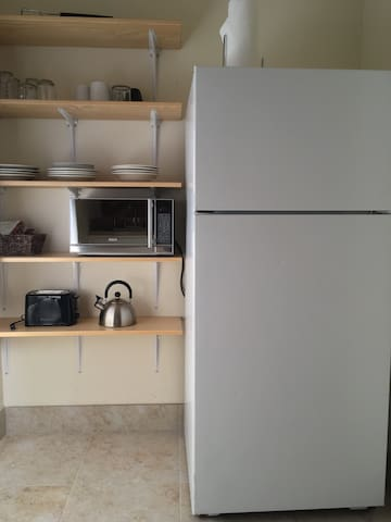 large kitchen area with all the amenities