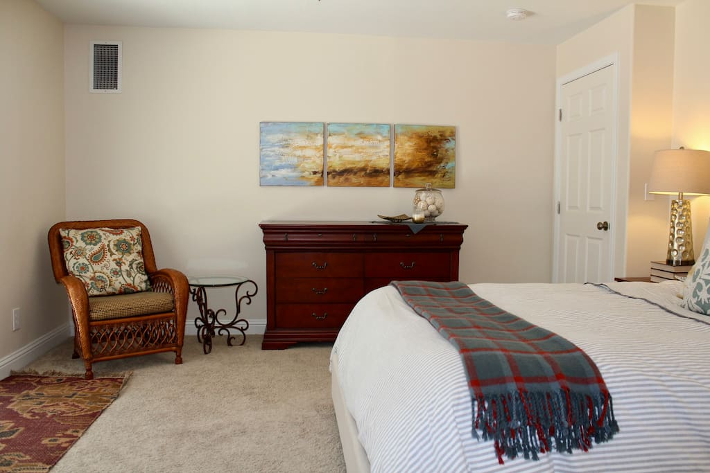 Your own private space for the night, with a dresser and a comfy chair to relax in.